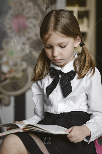 Portrait of a girl reading a book