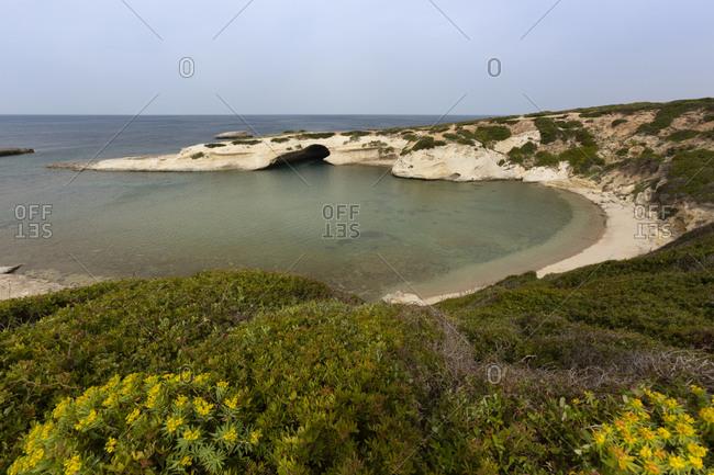 Italy- Sardinia- S'Archittu- rock arch at the coast