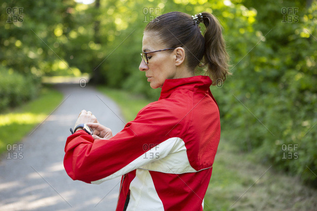 Female mature jogger in the forest