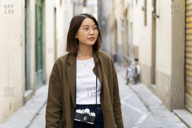 Italy- Florence- young woman strolling in an alley