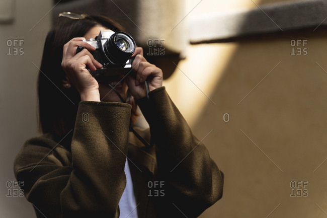 Italy- Florence- young tourist woman taking pictures in the city