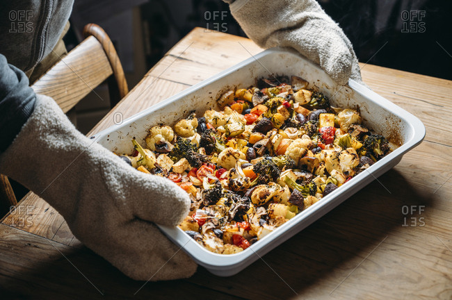 Baked vegetables with feta cheese in a baking pan