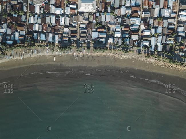 Indonesia- Sumbawa Island- Maluk- Aerial view of coastal town- beach