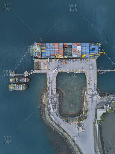 Indonesia- Sumbawa- Maluk- Aerial view of harbor- container ship from above