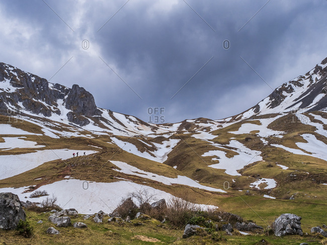 Spain- Asturias- Tuiza de Arriba- Cantabrian Mountains- people on their way to Pena Ubina
