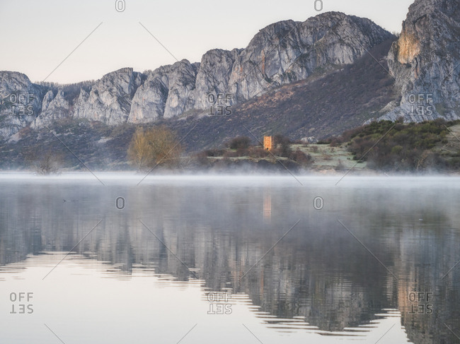 Spain- Asturias- Camposolillo- view over Porma reservoir with water vapor and Cantabrian Mountains