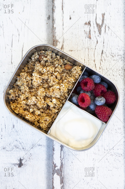Box with granola- greek yogurt- blueberries and raspberries