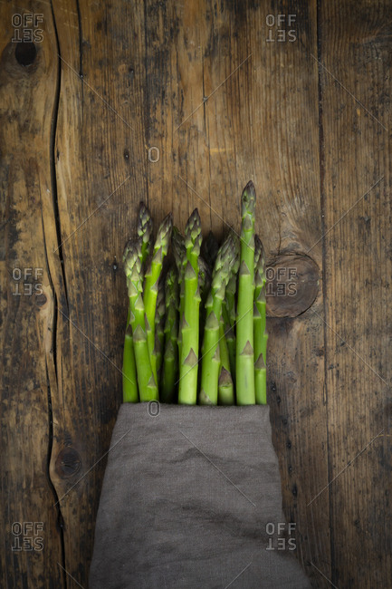 Bunch of green asparagus- kitchen towel