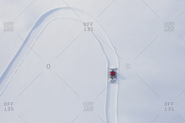 Austria- Tyrol- Galtuer- view to ski slope and snow groomer in winter- aerial view
