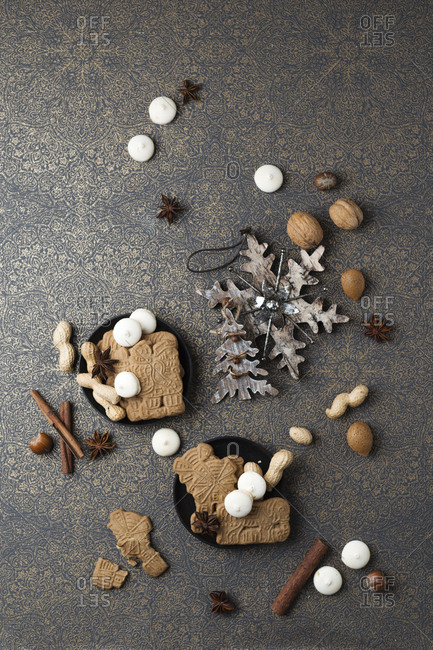 Christmas cookies and Christmas decoration on patterned ground