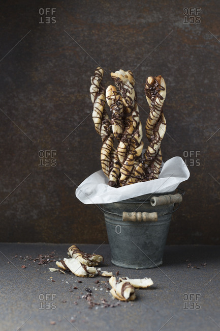 Puff paste sticks with cocoa and cocoa nibs