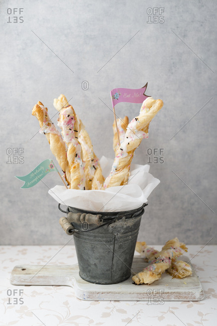 Puff paste sticks with sugar icing and granules