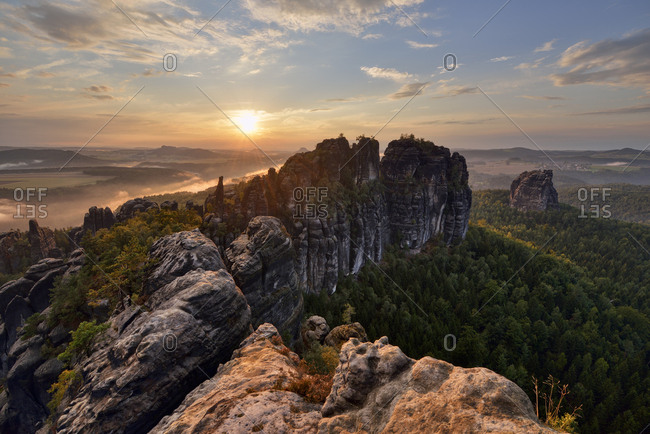 Germany- Saxony- Elbe Sandstone Mountains- rocks and rock needles of the Schrammsteine and Falkenstein at sunset