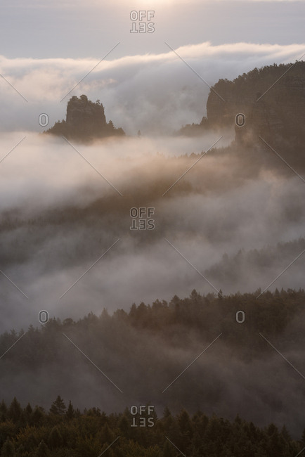 Germany- Saxony- Elbe Sandstone Mountains- view from Gleitmannshorn to sandstone rocks with fog at sunrise