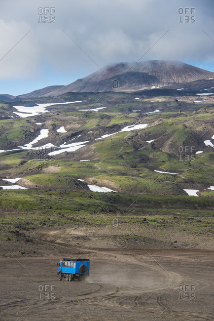 Russia- Kamchatka- Gorely volcano- truck driving through the lava sand
