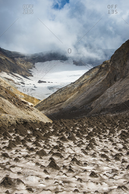 Russia- Kamchatka- Mutnovsyk volcano- little sand mounds on a glacier