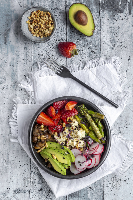 Veggie bowl with quinoa- vegetables- feta- strawberries- avocado- pine nuts and cress