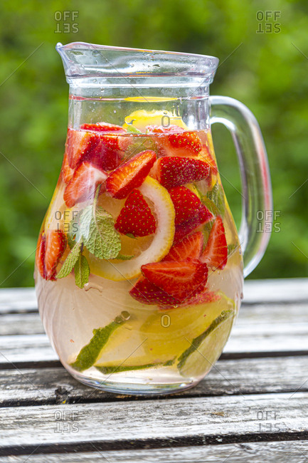 Detox water with strawberry- lime- lemon and mint in a glass jar