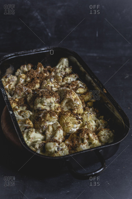 Casserole of baked cauliflower florets with Hollandaise and breadcrumbs