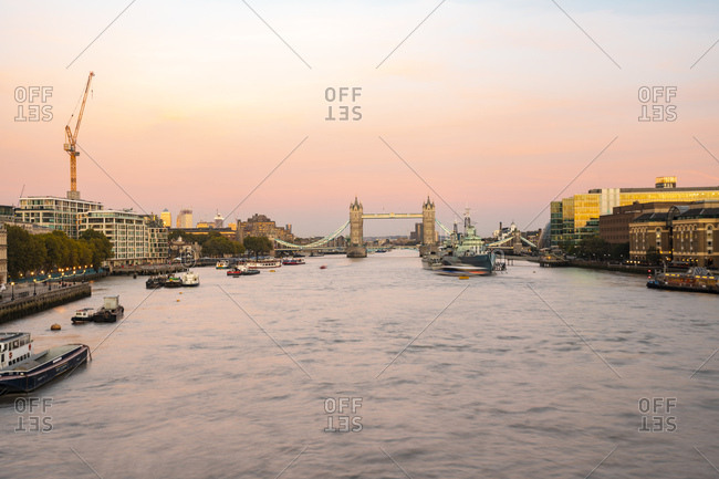 September 29, 2018: UK- London- The Tower Bridge with the HMS Belfast at sunset with purple sky