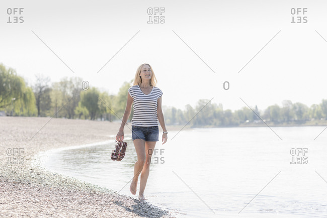 Smiling mature woman wading in a river