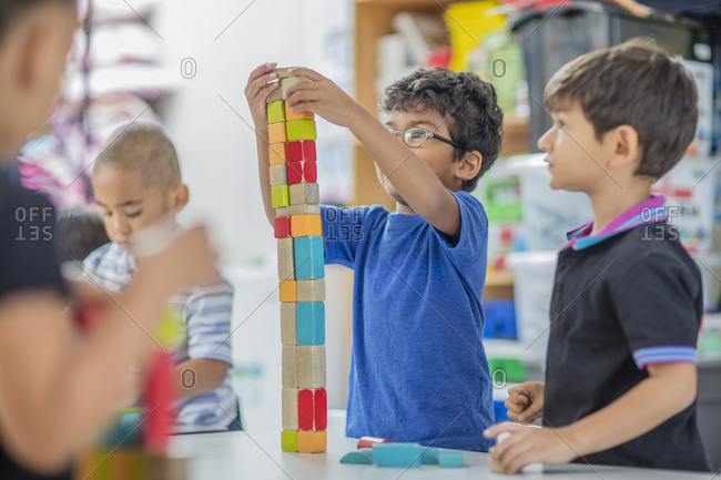 Boys stacking building blocks in kindergarten