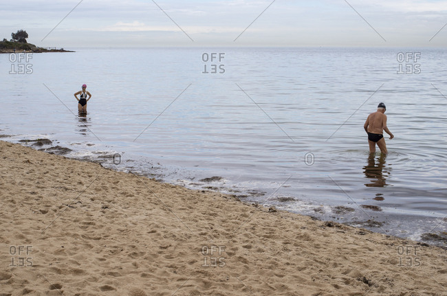 Melbourne, Australia - November 5: 2018: Two swimmers standing in the ocean