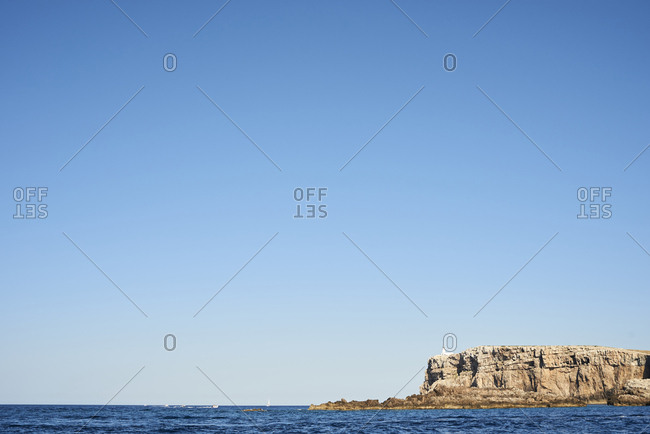 Coastline view from a sailing boat in a mediterranean island. Menorca, Spain.