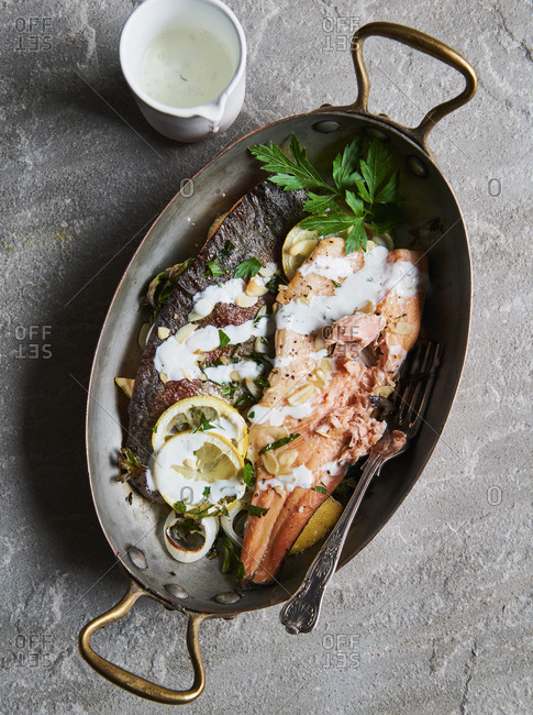 Broiled trout and almonds and a dill creme fraiche sauce