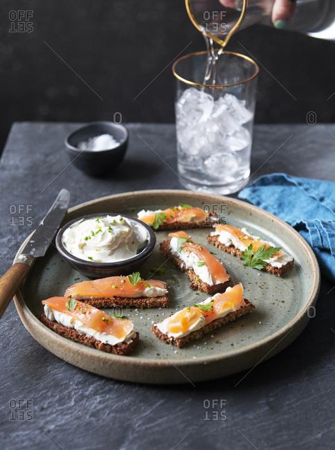 Smoked salmon and cream cheese on rye toasts