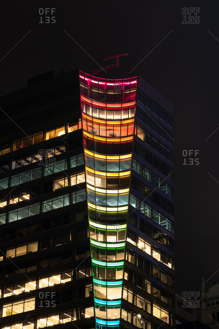 New York City - USA - Jun 20 2019: Night view of rainbow light display on buildings in midtown Manhattan
