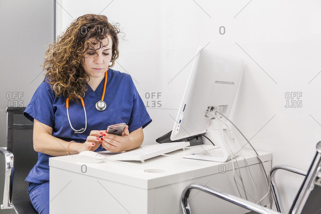 Female veterinarian consults patient data in the computer
