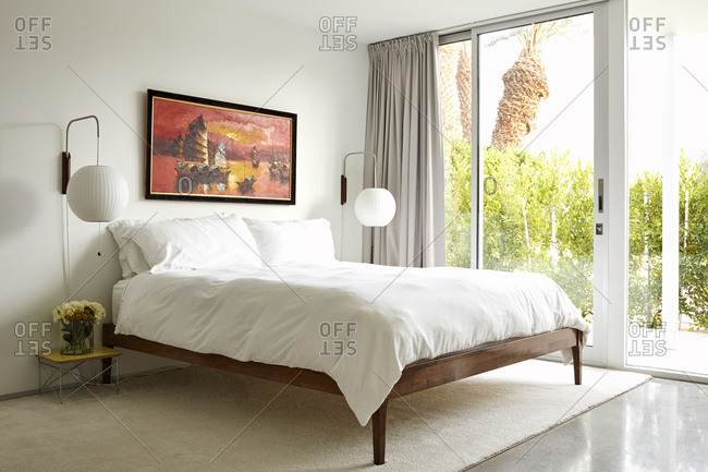 February 26, 2019: Bedroom with bright windows in a modern home