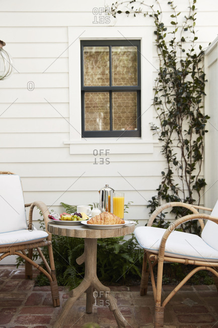 Patio with wicker chairs and wooden table