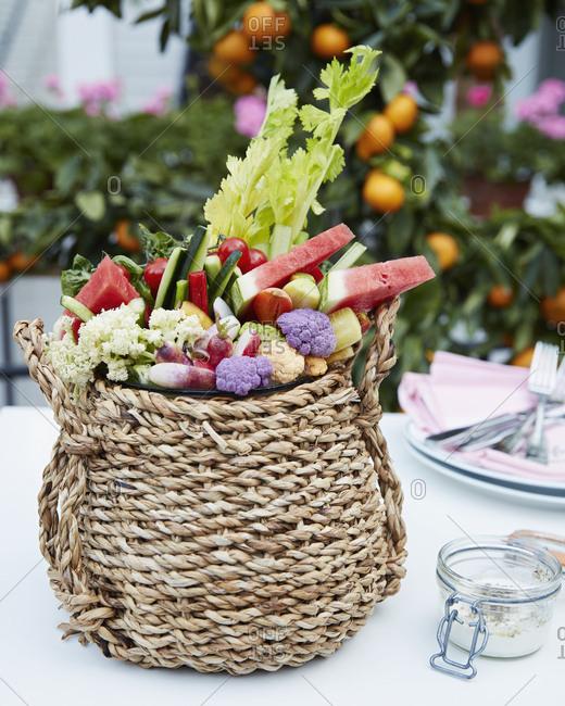 Basket filled with fresh fruit and vegetables