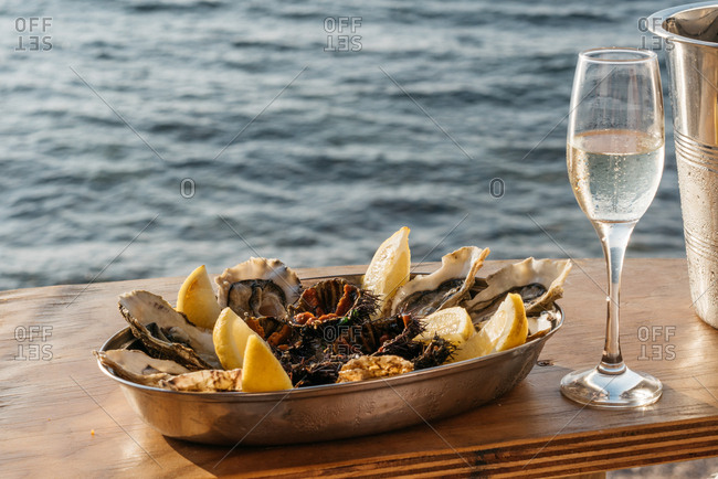 Oysters and wine by the sea, Sicily, Italy
