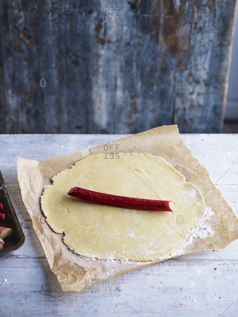 A rhubarb galette being prepared and made