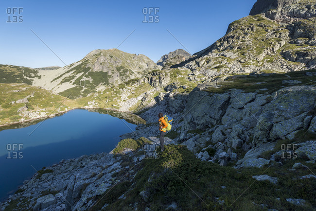 Man taking in the view while hiking in the Maliovitsa lakes in the Rila mountains, Bulgaria
