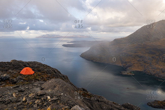Wild camping on Sgurr Na Stri on the Isle of Skye in the Scottish Highlands with views towards Loch Coruisk and the main Cuillin ridge