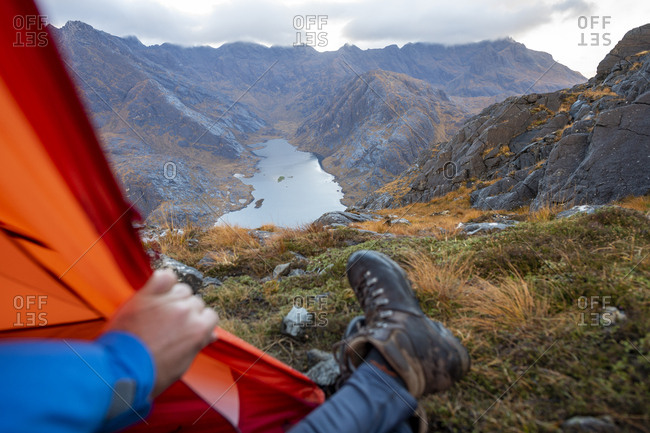 Wild camping on the top of Sgurr Na Stri on the Isle of Skye in the Scottish Highlands with views towards Loch Coruisk and the main Cuillin ridge