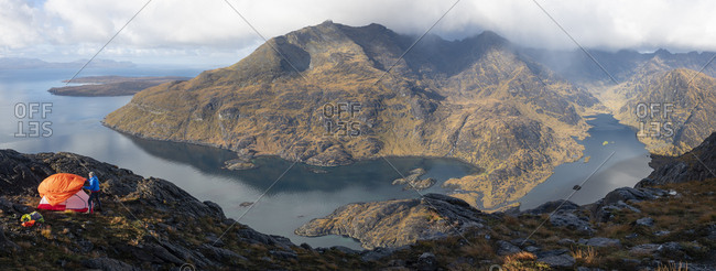Panoramic view of camping on the top of Sgurr Na Stri on the Isle of Skye in the Scottish Highlands with views towards Loch Coruisk and the main Cuillin ridge