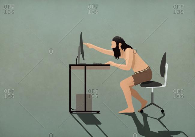 Caveman touching computer screen