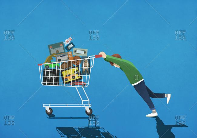 Boy pushing shopping cart full of toys