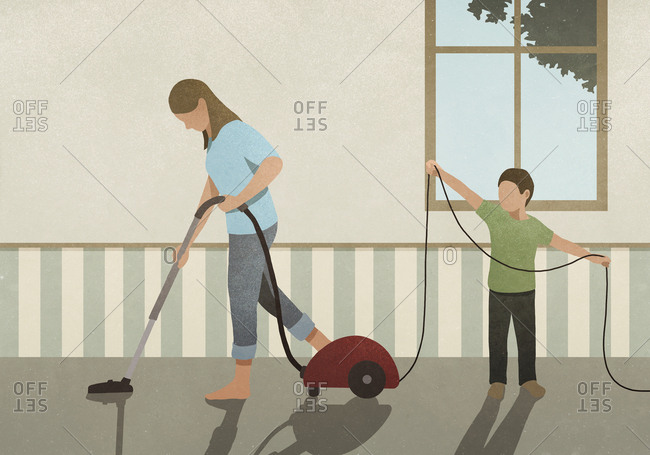 Son helping mother vacuum carpet