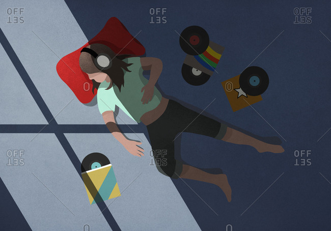 Girl with headphones relaxing, listening to records