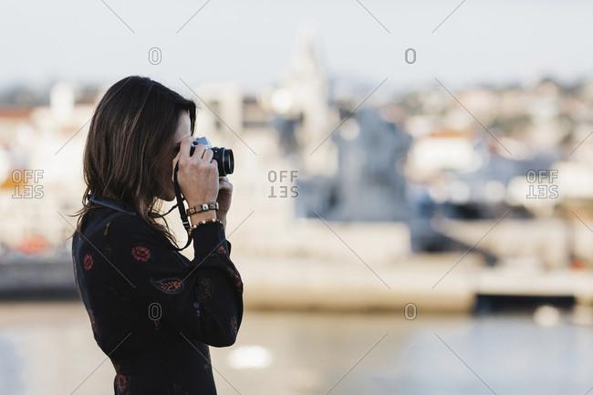 Female tourist using camera, Cascais, Lisbon, Portugal