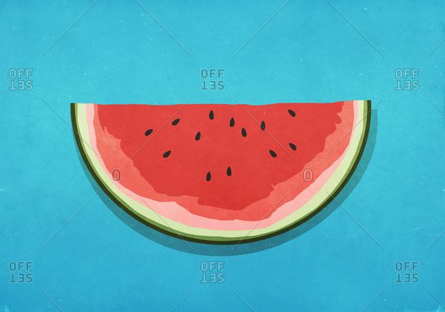 Watermelon slice on blue background