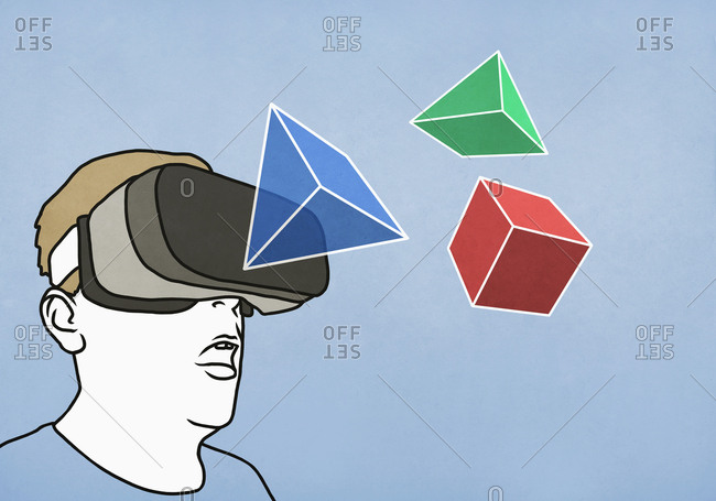 Man with virtual reality simulator glasses looking at 3D geometric shapes