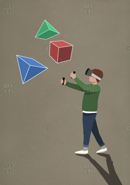 Boy with virtual reality simulator glasses looking at 3D geometric shapes