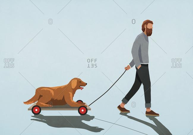 Man pulling dog on cart
